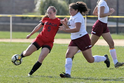 Sara Shwahla (left) from Point Pleasant Beach gets her foot on the ball ahead of a South River defender as South River High School headed down to the Shore to take on Point Pleasant Beach High School in the 2nd round of the NJSIAA Girls Soccer Tournament held in Point Pleasant Beach on Thursday November 1, 2018. (MARK R. SULLIVAN/THE OCEAN STAR)