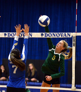 #5, KATE STOUGHTON OF THE BRICK MEMORIAL HIGH SCHOOL GIRL'S VARSITY VOLLEYBALL TEAM RETURNS A VOLLEY OVEER TO THE DONOVAN CATHOLIC SIDE OF THE NET DURING THEIR MATCH PLAYED ON 10/23/2018. (STEVE WEXLER/THE OCEAN STAR).