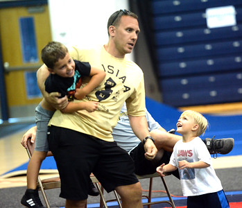 WRESTLING COACH BRIAN GRAINER OF POINT PLEASANT BORO HIGH SCHOOL HAS HIS HSNDS FULL OF COACH BRADY'S SONS PATRICK BRADY AND SEAN BRADY LOOKING ON DURING A SUMMER DUALS MATCH AT TOMS RIVER NORTH HIGH SCHOOL ON 07/23/2018. (STEVE WEXLER/THE OCEAN STAR).