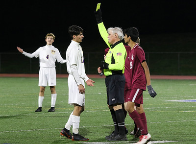 the ref giving no.14, Jonathan Caputo a yellow card. St. Rose High Scholl boys soccer v/s Trinity Hall in Holmdel,NJ on 11/8/18. [DANIELLA HEMINGHAUS | THE COAST STAR]