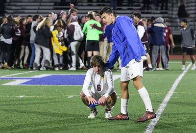 no.6, Matt Deluca being comforted by a teammate after the match. St. Rose High Scholl boys soccer v/s Trinity Hall in Holmdel,NJ on 11/8/18. [DANIELLA HEMINGHAUS | THE COAST STAR]