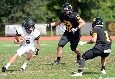 #9 PANTHER QUARTERBACK GARRETT ROMER OF THE POINT PLEASANT HIGH SCHOOL VARSITY FOOTBALL TEAM OF POINT PLEASANT, NEW JERSEY MAKES HIS WAY DOWNFIELD AGAINST THE MONMOUTH REGIONAL DEFENSE IN THE GAME PLAYED AT MONMOUTH REGIONAL HIGH SCHOOL, IN TINTON FALLS, NEW JERSEY ON 09/22/2018. (STEVE WEXLER/THE OCEAN STAR).