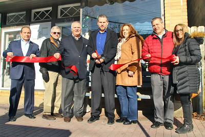 Ribbon cutting outside of the Point Pleasant Beach Chamber of Commerce office in Point Pleasant Beach on Tuesday December 12,2018. (MARK R. SULLIVAN /THE OCEAN STAR)