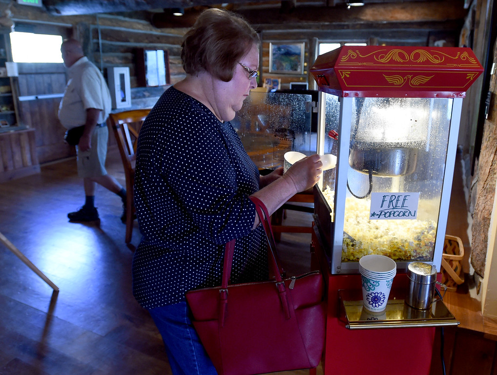 . Carole Stickels, of Omaha, gets popcorn at the gallery on Thursday. The Old Gallery in Allenspark is in danger of shutting down. They have access to a matching grant, but they have to raise like $350K. For more photos and a video, go to dailycamera.com.  Cliff Grassmick  Staff Photographer September 7, 2017