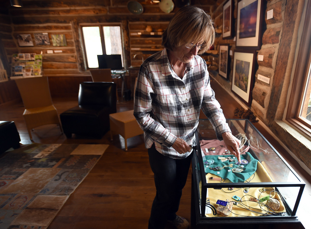 . Contributing artist Sally Van Der Kamp, arranges the jewelry she made for the gallery. The Old Gallery in Allenspark is in danger of shutting down. They have access to a matching grant, but they have to raise like $350K. For more photos and a video, go to dailycamera.com.  Cliff Grassmick  Staff Photographer September 7, 2017