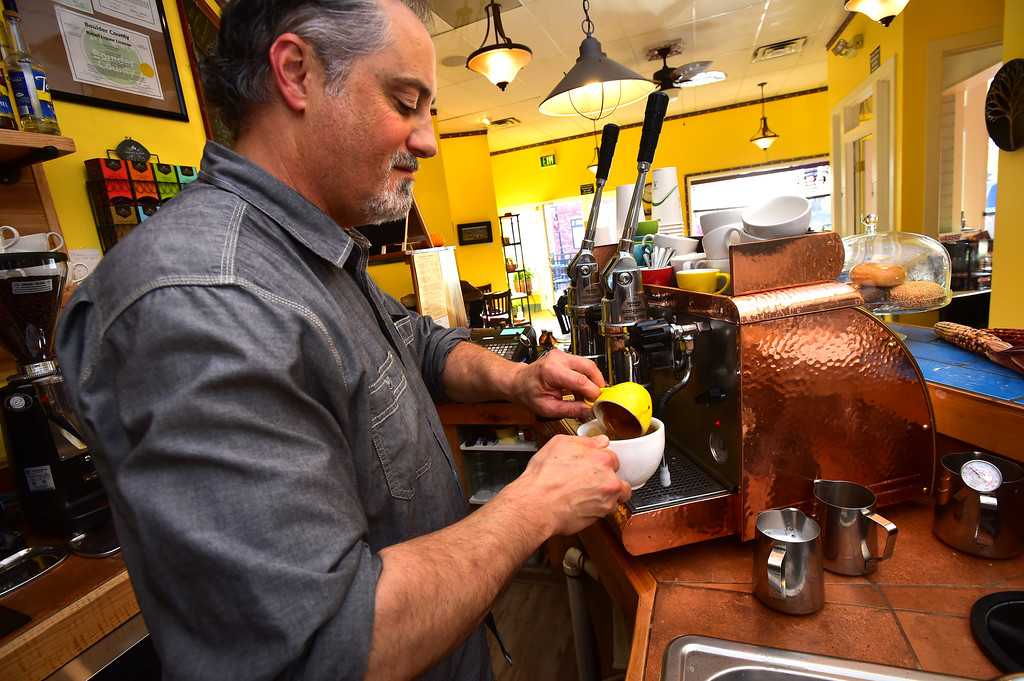 . Co-Owner Michael Tomich makes a cappuccino the Old Oak Coffeehouse in Niwot Paul Aiken Staff Photographer Nov 8, 2017