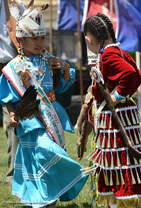"""Nora Carino, 7, from San Jose and of the Kicarilla Apache, left, talks to her cousin Abigail """"Morning Star"""" Lone Bear, 6, of the Hidatsa/Mandan tribe of North Dakota, as they dance Saturday, May 27, 2017, during the Oroville Pow Wow at Gold Country Casino in Oroville, California. (Dan Reidel -- Enterprise-Record)"""