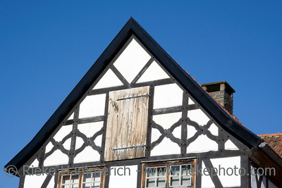 gable of a half-timbered house in black and white - in a traditional german village