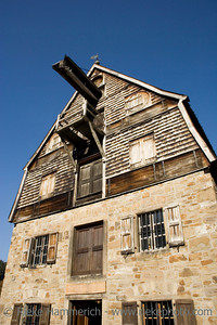 an ancient brewery with wooden shingles - against a blue sky