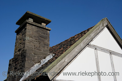 roof of an ancient house of poor people - against a deep blue sky