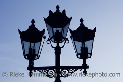 silhouette of three lanterns - in the twilight