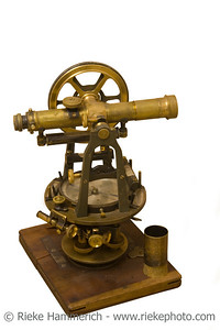 antique measuring instrument of surveying and alignment - made from brass on a wood plate  - incl. path - adobe RGB