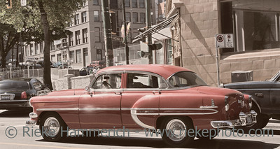Vancouver, British Columbia, Canada – August 6, 2005: Chevrolet Bel Air driving through Downtown Vancouver, Canada. This vintage car is a full-size automobile that was produced by the Chevrolet division of General Motors. Hardtops in the Chevrolet Deluxe Styleline model range were designated with the Bel Air name from 1950–1952.