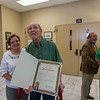 Bill Seales shows his proclamation from the city. His cousin, Alice Kennedy, stands with him.