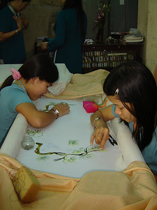 Vietnamese girls doing needlework.