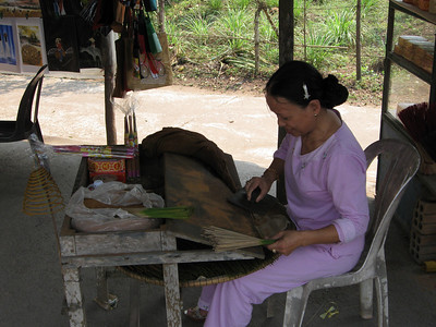 Lady hand making incense near the Tomb of Tu Duc in Hue.