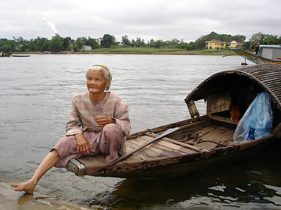 This older lady lives on her boat alone.  Here she waits at the Thien Mu Pagoda in Hue for someone to give her money to live on.