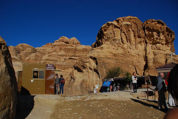 Here,we show our passes once again at the entrance to the Siq..you will also encounter hordes of Bedouin s who are hawking their tat and trying to pursuade the visitor to ride either a horse,a donkey or ride down the Sig in a horse drawn carriage.Way too expensive,so avoid at all costs.