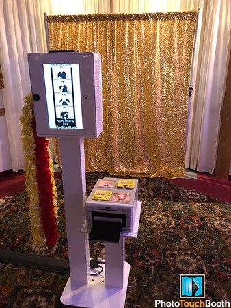 Our Photo Booth set up using our Golden Glitz Backdrop