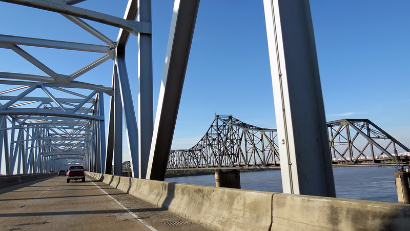 Until 1973, both vehicular and rail traffic crossed the river on the Old Vicksburg Bridge that dates from 1930.  The new bridge now handles all of the vehicle traffic while the old bridge still carries the rail line.