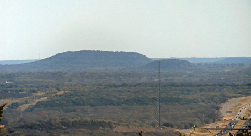 Two-picture panorama of the peaks off to the east of the rest area near the city of Gordon, TX.  I don't know the names of the two prominent mesas to the east near the city of Gordon, Texas seen in the photo below.  There are many in this area, most of which measure between 1,000 and 1,200 feet in elevation.