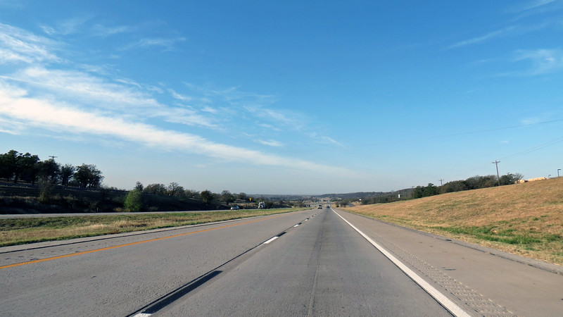 Westbound I-20, mile 391 near Millsap, TX.  A few rolling hills started to appear on the horizon.
