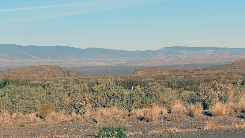 The valley in front of the mountains contains the Carrizozo Malpais, a large lava flow area formed around 5,000 years ago by lava from nearby Little Black Peak.