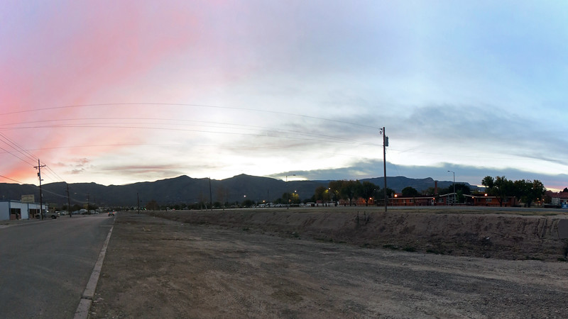 Three-picture panorama of the Sacramento Mountains east of Alamogordo, NM.  The two prominent peaks in the center of the photo are (L) Ortega Peak (7,695 feet), and (R) Hershberger Peak (7,850 feet).