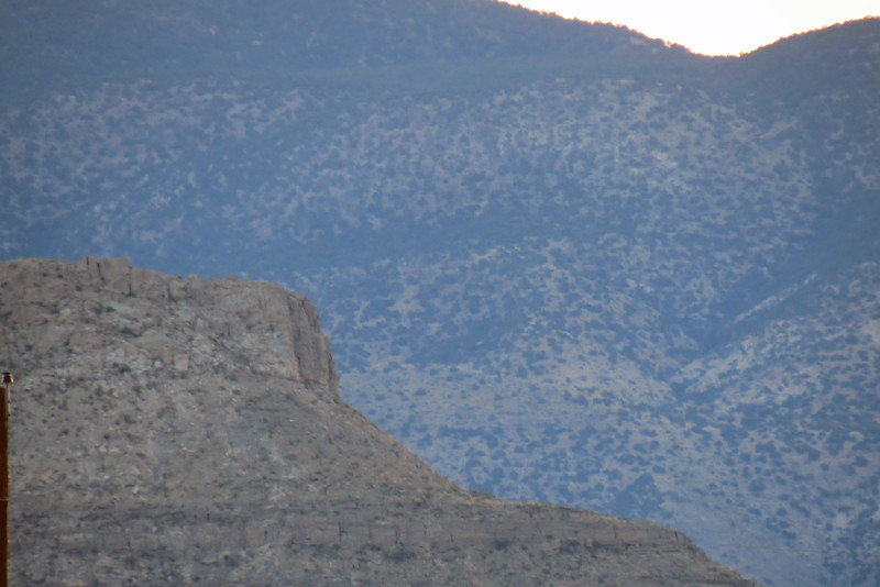 A 5,600-foot peak in front of the 8,000-foot peaks of the Sacramento Mountains, Tularosa, NM.