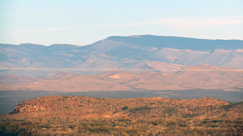 Looking west across the Tularosa Valley and the Carrizozo Malpais Lava Flow area toward the San Andres and Oscura Mountains.  The Carrizozo Malpais is known for its unusual 46 mile-long length.