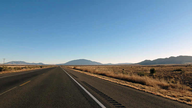 Approaching the town of Carrizozo, NM (population 955), three distinct peaks come into view.  I'm pretty sure the peaks are (L - R):  Lone Mountain (8,145 feet), Carrizo Peak (9,620 feet), and the Vera Cruz Mountains.