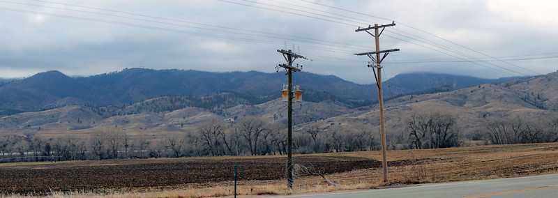 Four-picture panorama looking southwest near the entrance to Poudre Canyon.