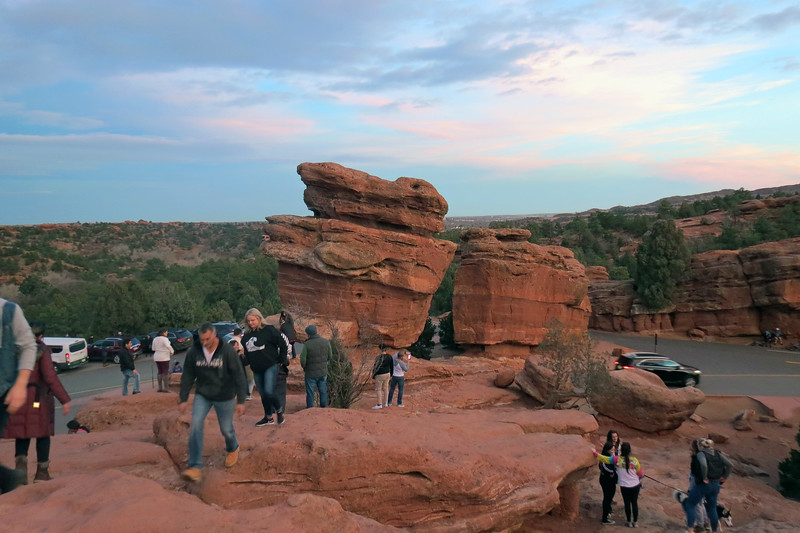 Once at the top of the hill, visitors make their way toward Balanced Rock for pics.