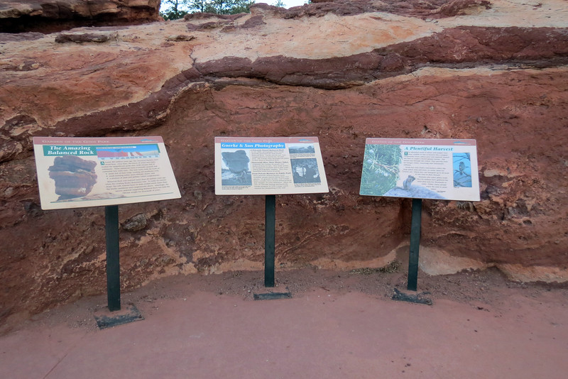 We decided to check it out and were greeted by signage at the base of the rock.  The marker on the left describes the geological processes I mentioned earlier, but in more detail.  The center marker tells the story of Paul Goerke, a photographer who owned the land around the rock in the 1890s and charged visitors 25 cents for a portrait.  The marker on the right describes the various wildlife in the area.