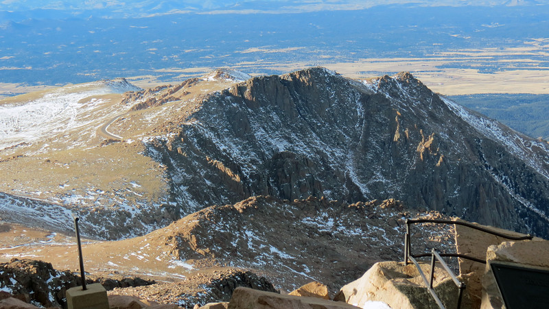 The above photo looks northwest beyond the Pike monument toward the Bottomless Pit and Devil's Playground.  The Pikes Peak Highway is visible in the upper right corner of the photo.