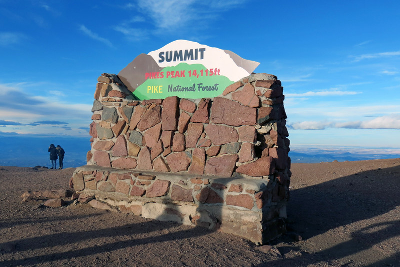 We got out of the car and started walking toward a crowd near the Summit House.  Two large signs mark the 14,115-foot elevation, with the one in the photo above located on the western side of the Summit House next to the parking area.  This is a popular photo op location for obvious reasons.  The view in the photo below looks north.