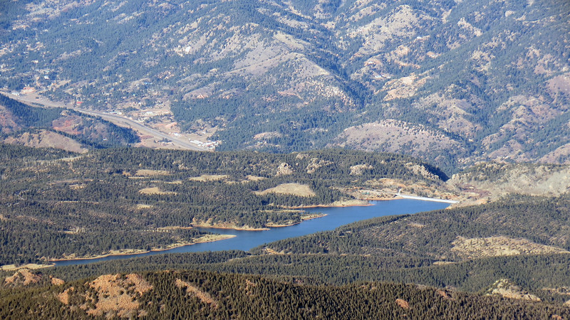 The Crystal Creek Reservoir near where this journey began.  The Pikes Peak Highway can be seen crossing over the end of the reservoir.  US Route 24 can be seen in the background.