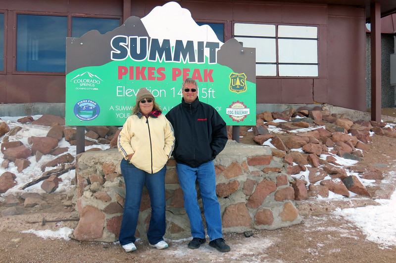 """We came down from the observation deck to check out the area around the train tracks near the Summit House.  The second of two """"Summit"""" signs sits next to the summit house near the end of the tracks."""