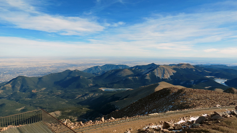 Beyond the monument was the incredible view I was expecting.  The photos above and below look to the southeast at the peaks on the eastern edge of the Pike National Forest.