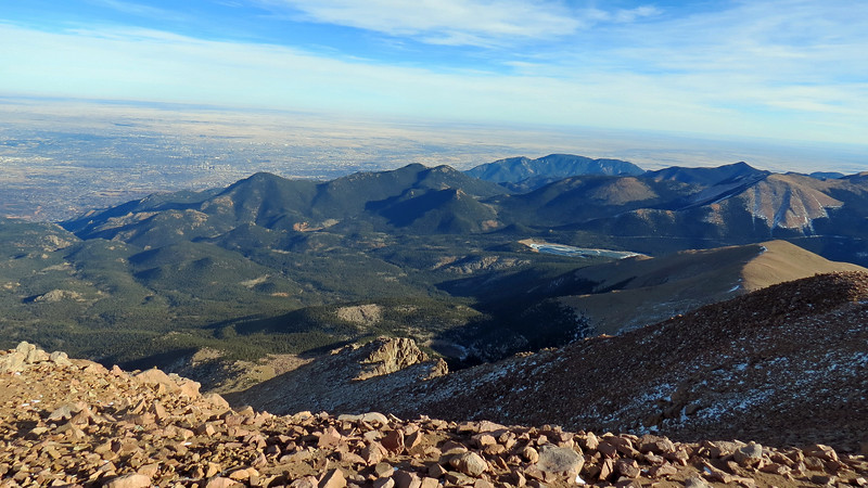 I started zooming in on various places.  The photos below look toward a rock formation on the side of Pikes Peak.