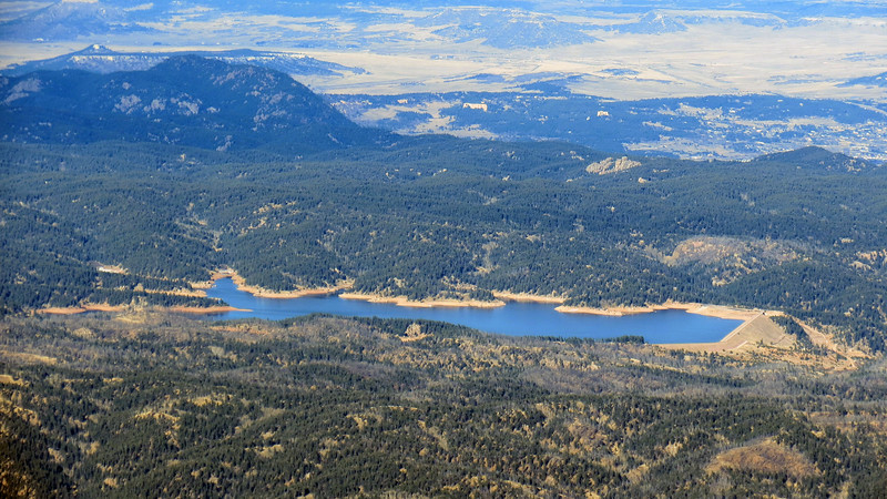 I believe the body of water seen in the photo above is the Rampart Reservoir which sits to the northeast of the summit.  The prominent peak on the left side of the photo is Mount Herman (9,063 feet).