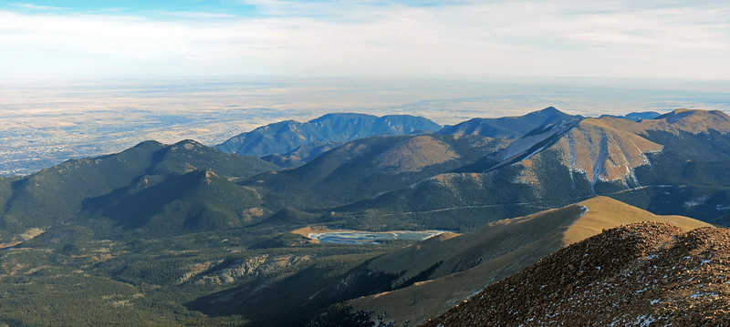 Two-picture panorama of the mountains to the southeast of the summit.
