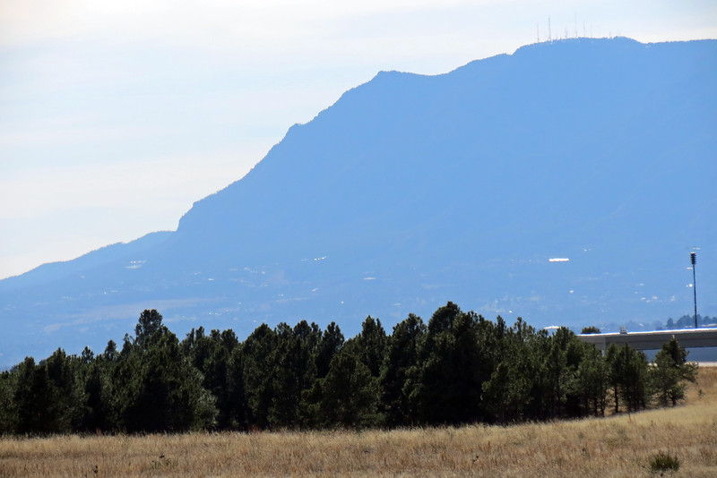 I put my 35x zoom lens to work and started zooming.  I could see Cheyenne Mountain (9,565 feet), and its array of radio towers on its peak to the southwest.