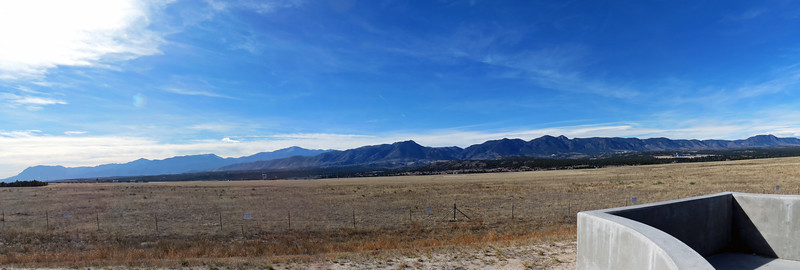 Three-picture panorama looking west at the Front Range outside of Colorado Springs.