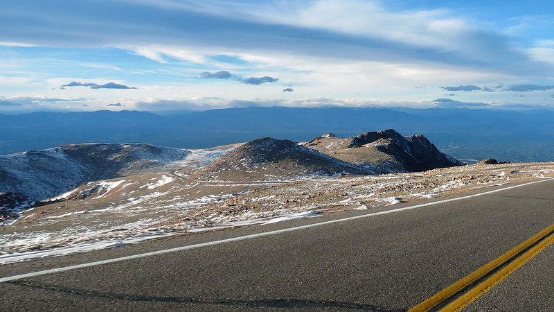 The Pikes Peak Highway can be seen on the left side of the photo going around Little Pikes Peak (13,363 feet), on its way to the Bottomless Pit.