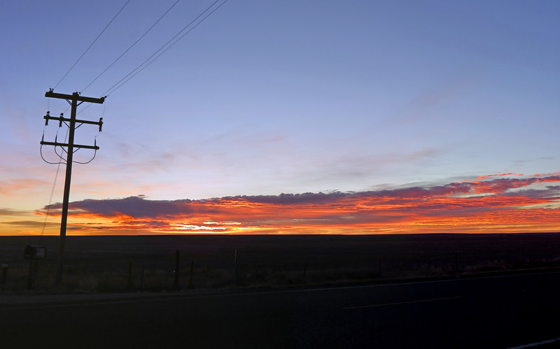 Three-picture panorama of sunrise from Colorado Route 71 and County Road 19.