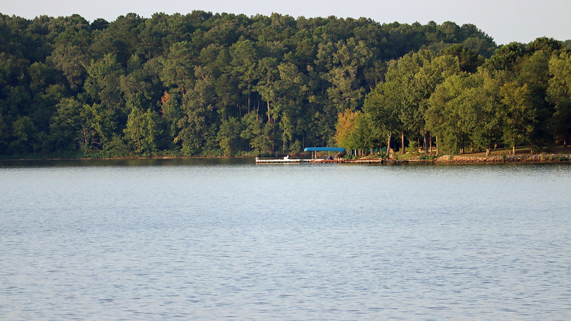 I pulled out the long lens to see what I could see.  The photo above shows what I think is another private boat dock.