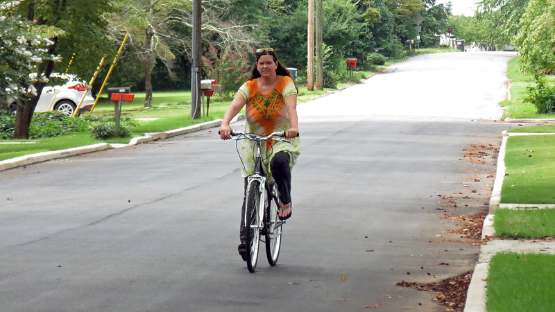 My friend, Danita, took delivery of her new bicycle today, and took it for a brief spin around her neighborhood.