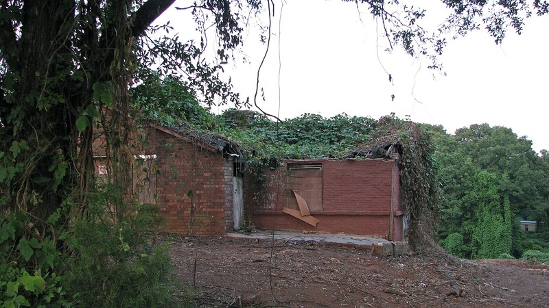 I was driving down Timothy Road on this day and noticed some activity at the abandoned and overgrown house.  Someone has been busy cutting a good chunk of the vines away.  The brick structure looks to be intact, but the roof is shot.