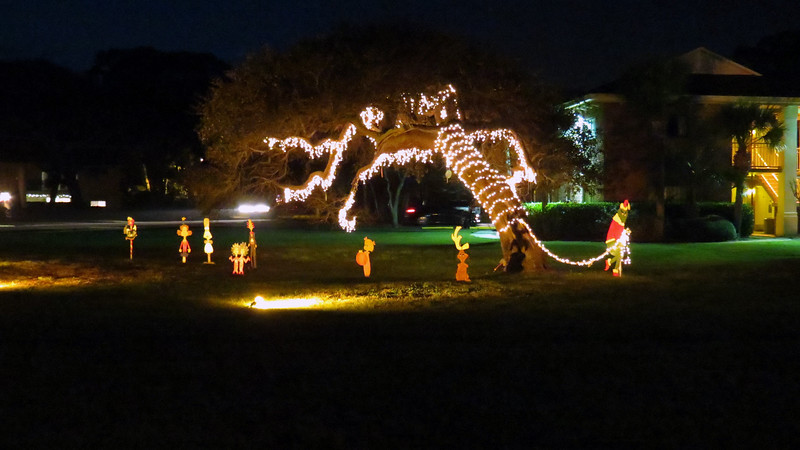 The large leaning Live Oak tree in the grass was decorated in a Grinch theme.